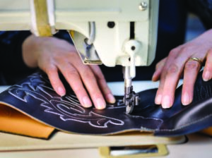 Stitching the leather at Alberta Boot Company