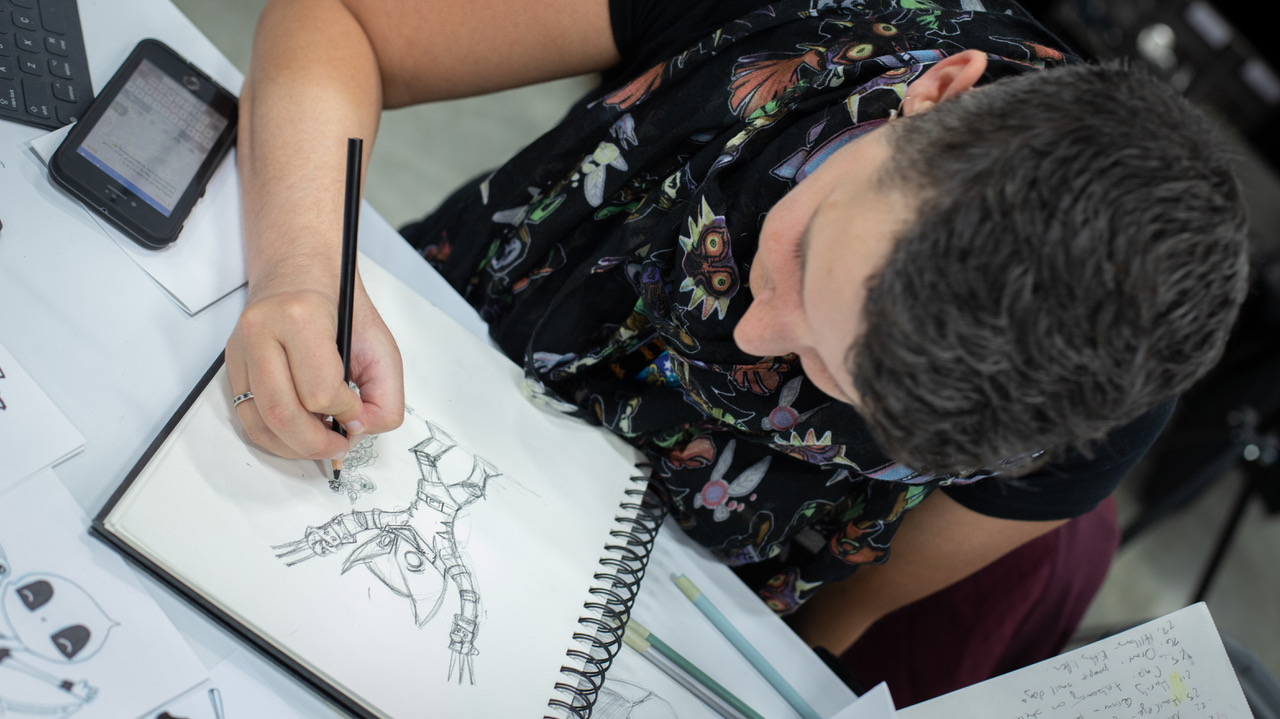 An artist drawing at the Calgary Expo